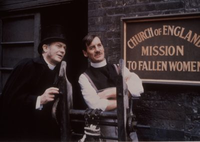 The Missionary - Bishop and Fortescue outside missionary sign
