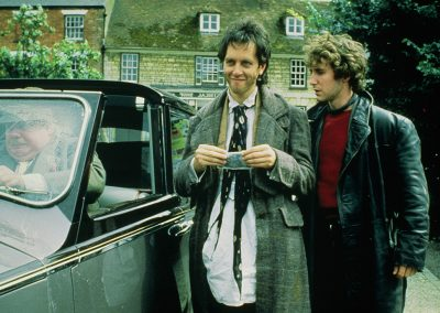 Withnail & I - Withnail and Marwood outside by car